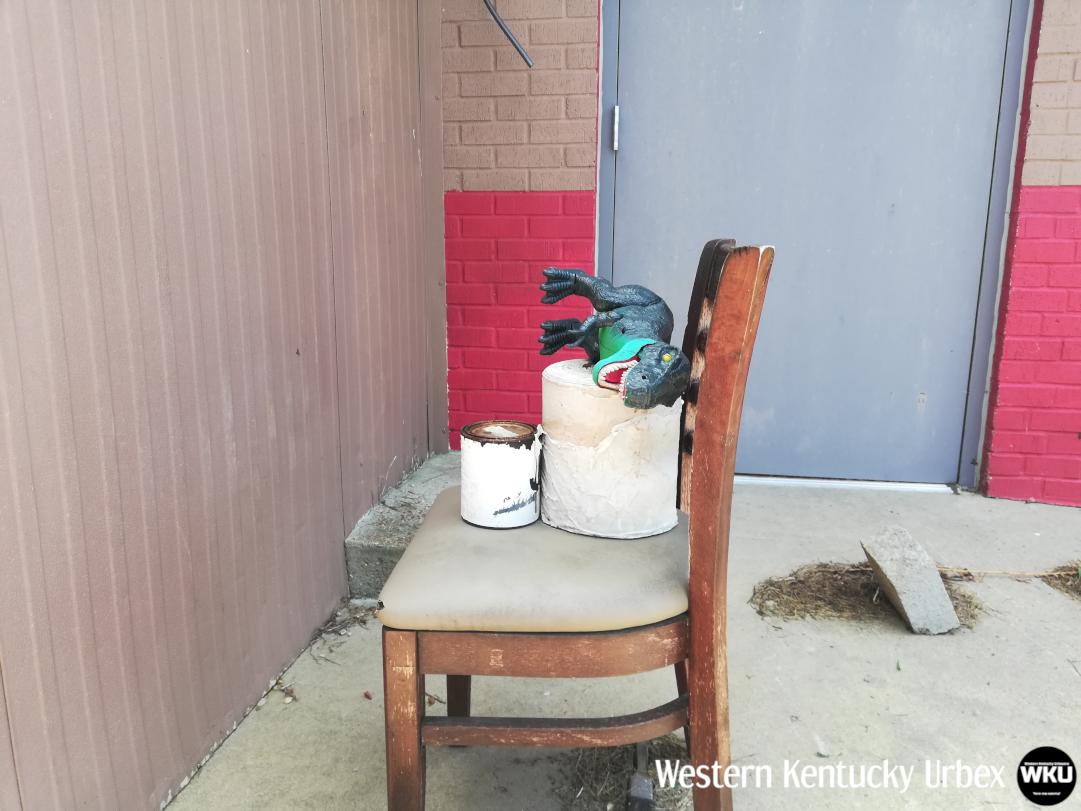 huddlehouse_exterior_dinosuar_chair.png